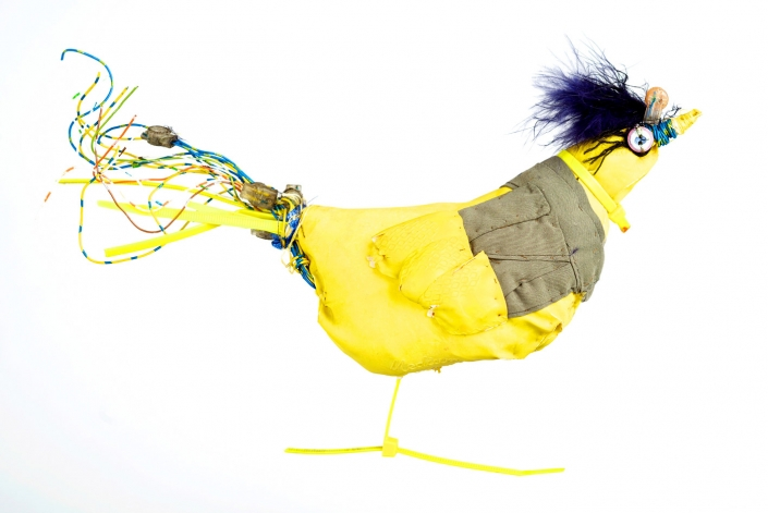 Yellow Bird, rubber glove, wire, feather